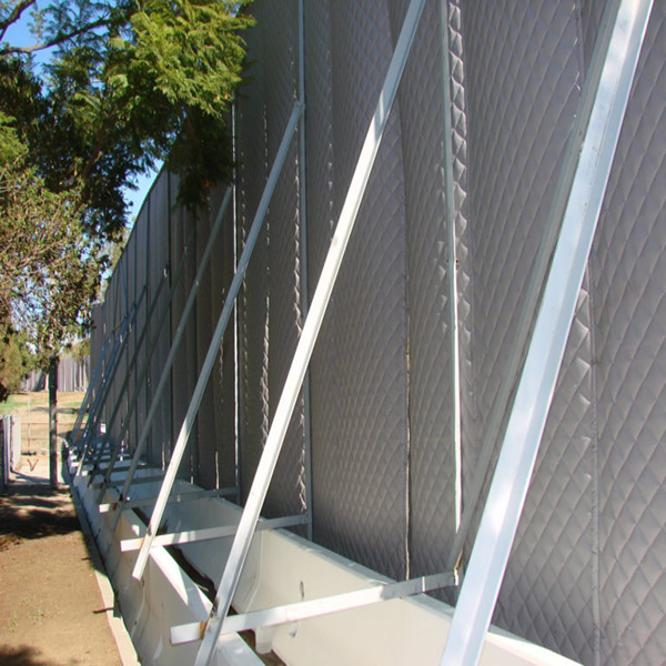 Sound blankets on construction fence.